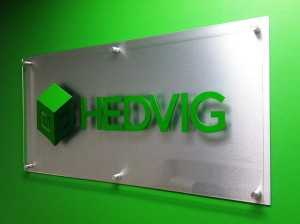 Dimensional Lobby Sign with brushed silver backer panel